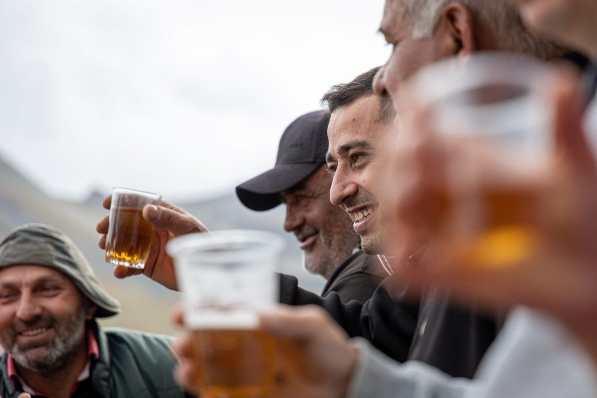 group of men drinking alcohol from plastic cups
