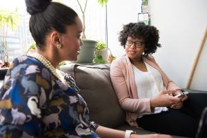 black women sitting talking