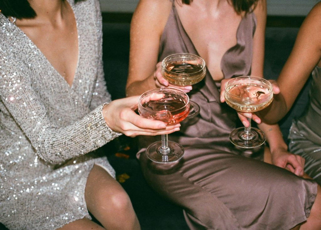 ladies sitting with alcohol drinks