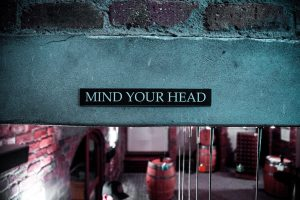 """sign that states """"mind your head"""""""