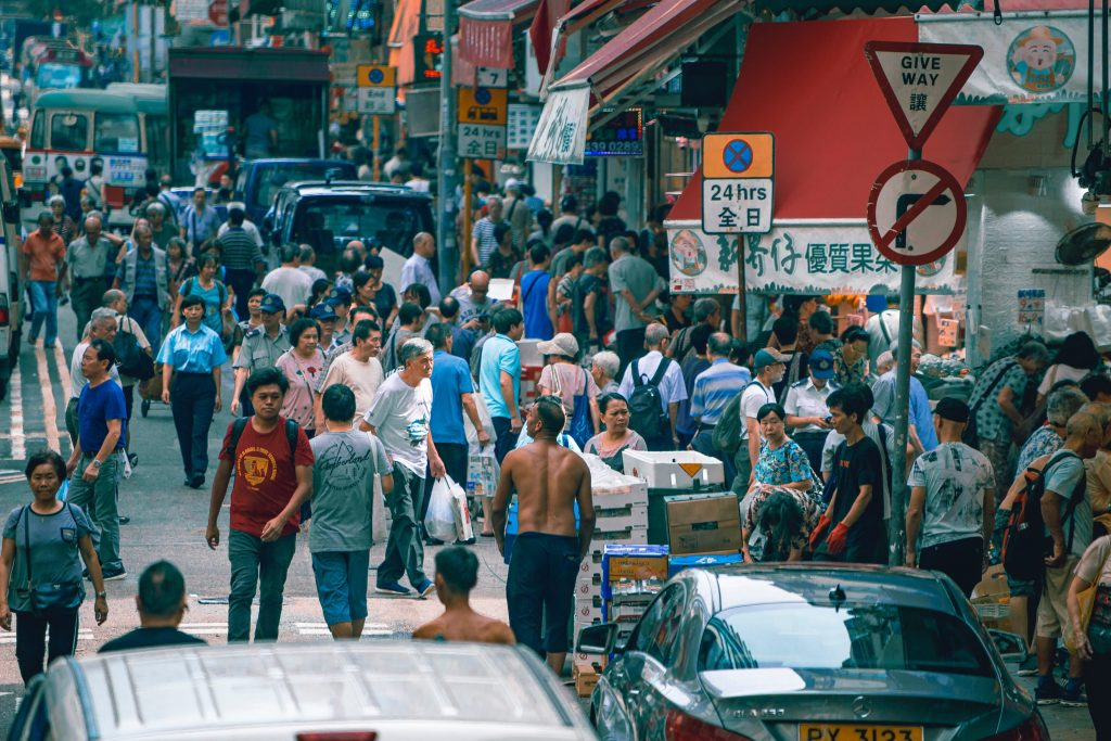 people on the street in a busy market