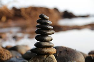 pebbles balancing on top of one another, at the sea side