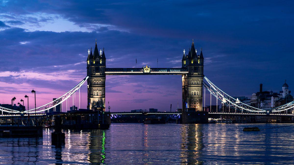 london bridge at dusk with lights on
