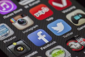 app icons on a smartphone, including facebook and twitter