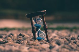 The sands of time in an hourglass