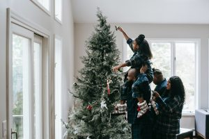 Family setting up Christmas Tree