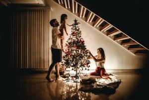 Family decorating the tree